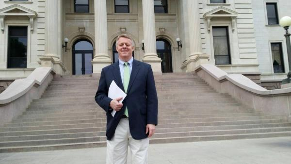 Issuing a report at the South Dakota state capitol.